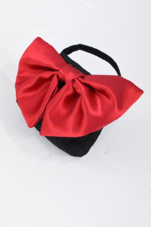 Mona Lucero Baby Bag Red Bow Side